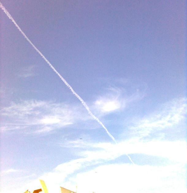 Linear mark left by a jet plane.