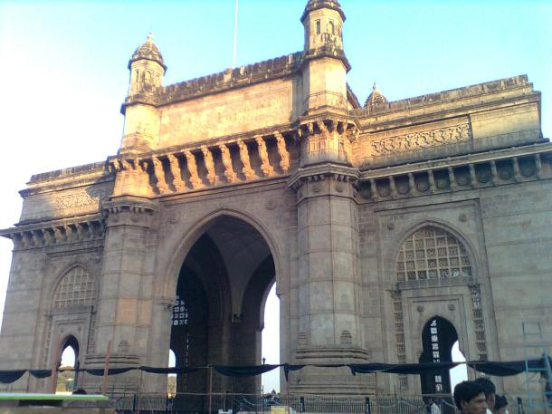 The Gateway of India is a monument built during the British Raj in Mumbai, India. It is located on the waterfront in the Apollo Bunder area in South Mumbai and overlooks the Arabian Sea. The structure is a basalt arch, 26 metres high. Wikipedia
